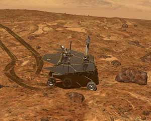 The Mars Exploration Rover drives over to study a particularly interesting rock. Image credit NASA/JPL.