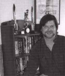 Allen Steele with his Hugos - Picture  Copyright © 2002 by Linda Steele.