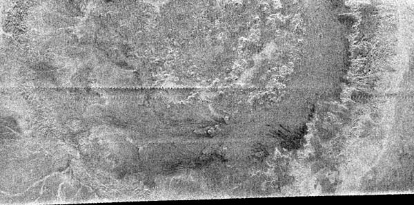 Cassini image of large crater on Titan. Image credit NASA/JPL.