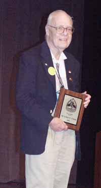 Hal Clement accepting the First Fandom Hall of Fame award for Arthur C. Clarke. Picture Copyright © 2002 by Suzanne Gibson.  All Rights Reserved.