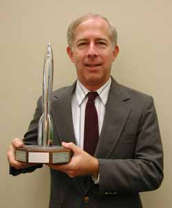 Melvin Schuetz the archivist for the Chesley Bonestell collection with the Hugo award he received for his work on The Art of Chesley Bonestell.  Click on his picture to go to the Chesley Bonestell archives.
