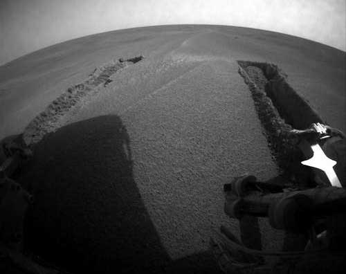Opportunity - tracks left in the sand as Opportunity gets unstuck. Image credit NASA/JPL.