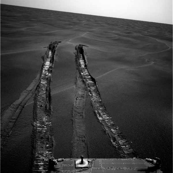 Opportunity - tracks left in the sand after it got unstuck. Image credit NASA/JPL.